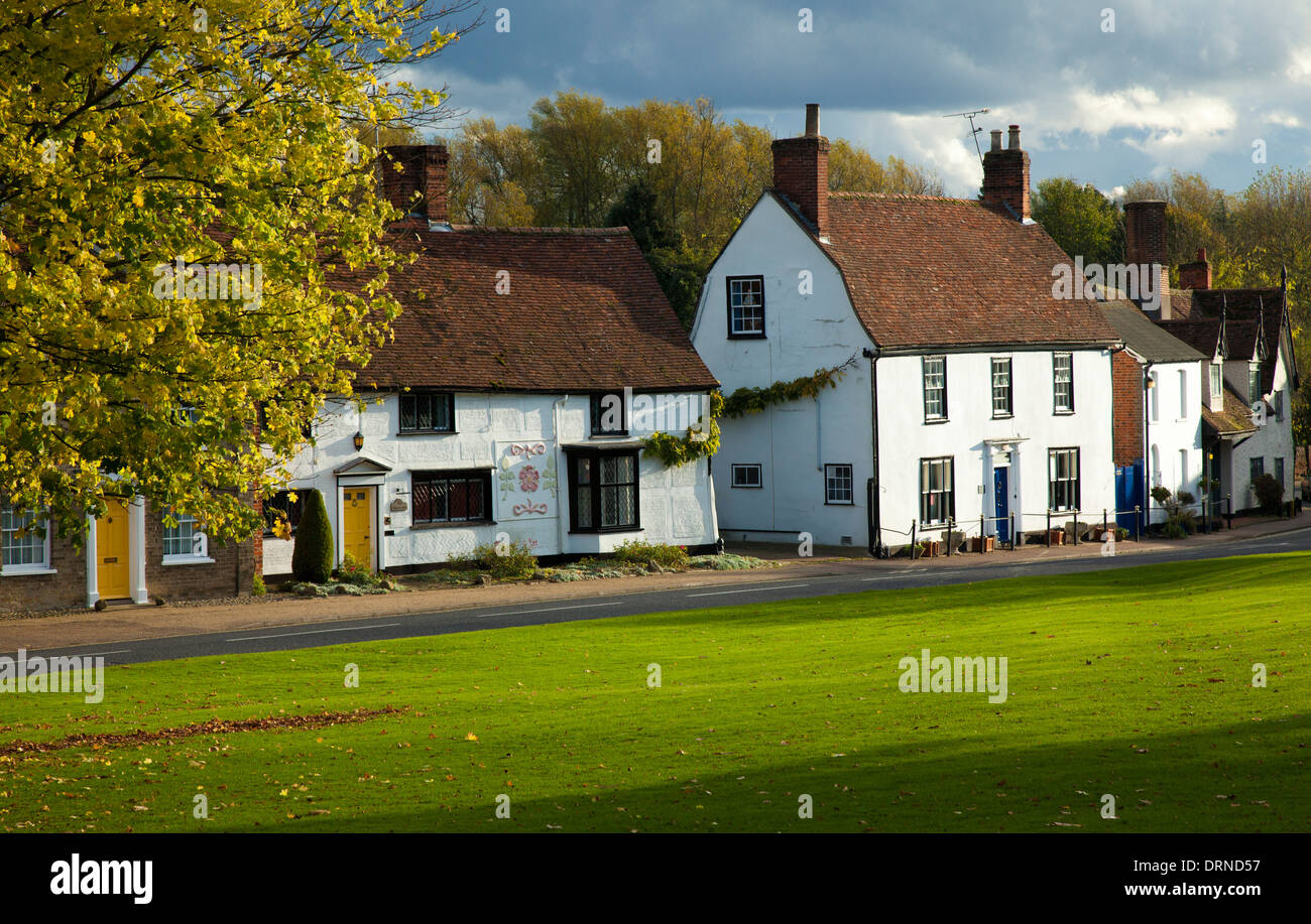 Tudor houses beside the village green in Cavendish, Suffolk, England. - Stock Image