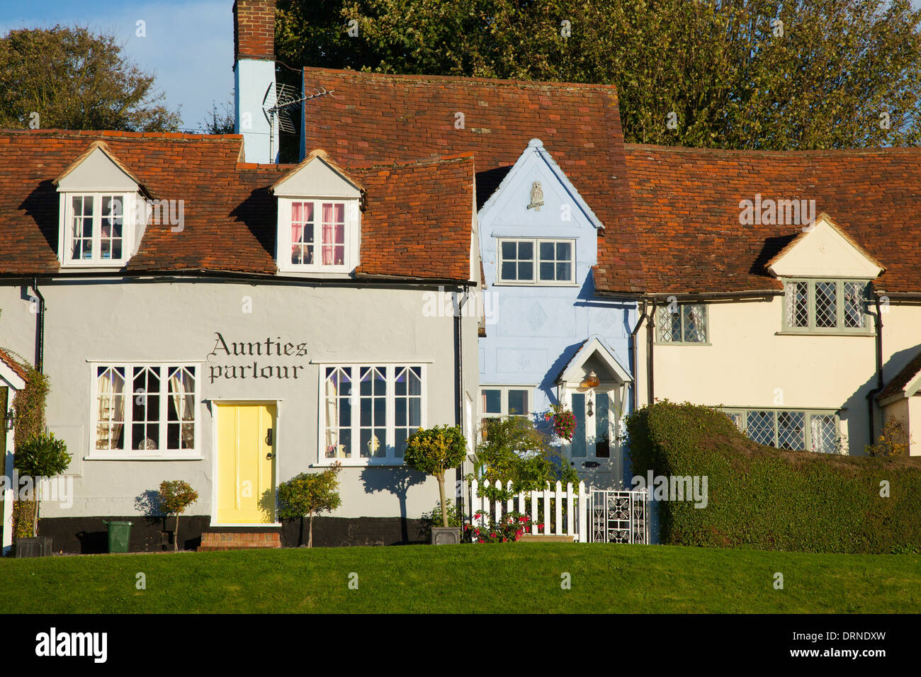 A row of medieval cottages line the village green in Finchingfield, Essex, England. - Stock Image
