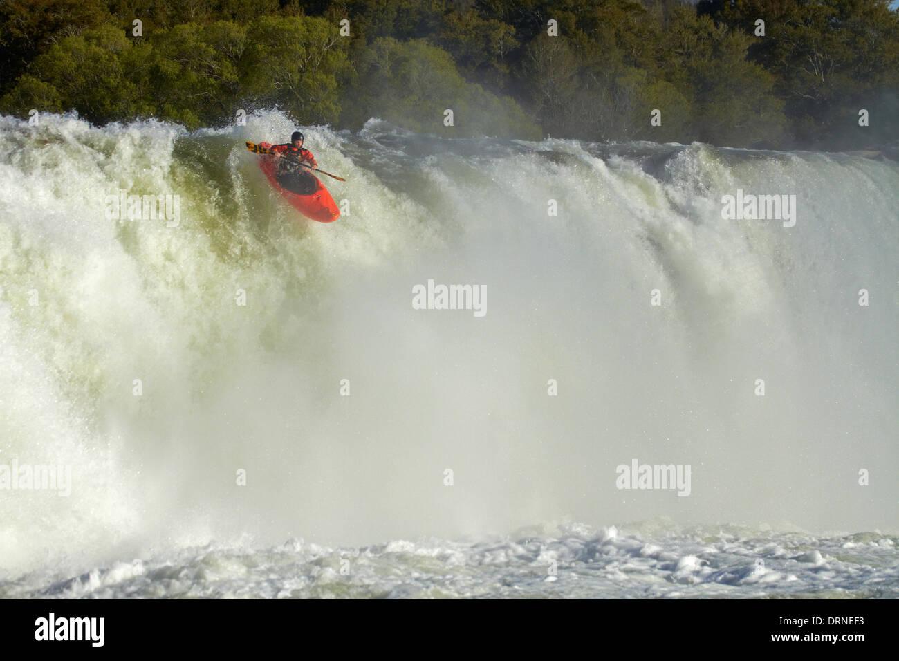 Whitewater kayaker going over Maruia Falls, near Murchison, Tasman District, South Island, New Zealand - Stock Image