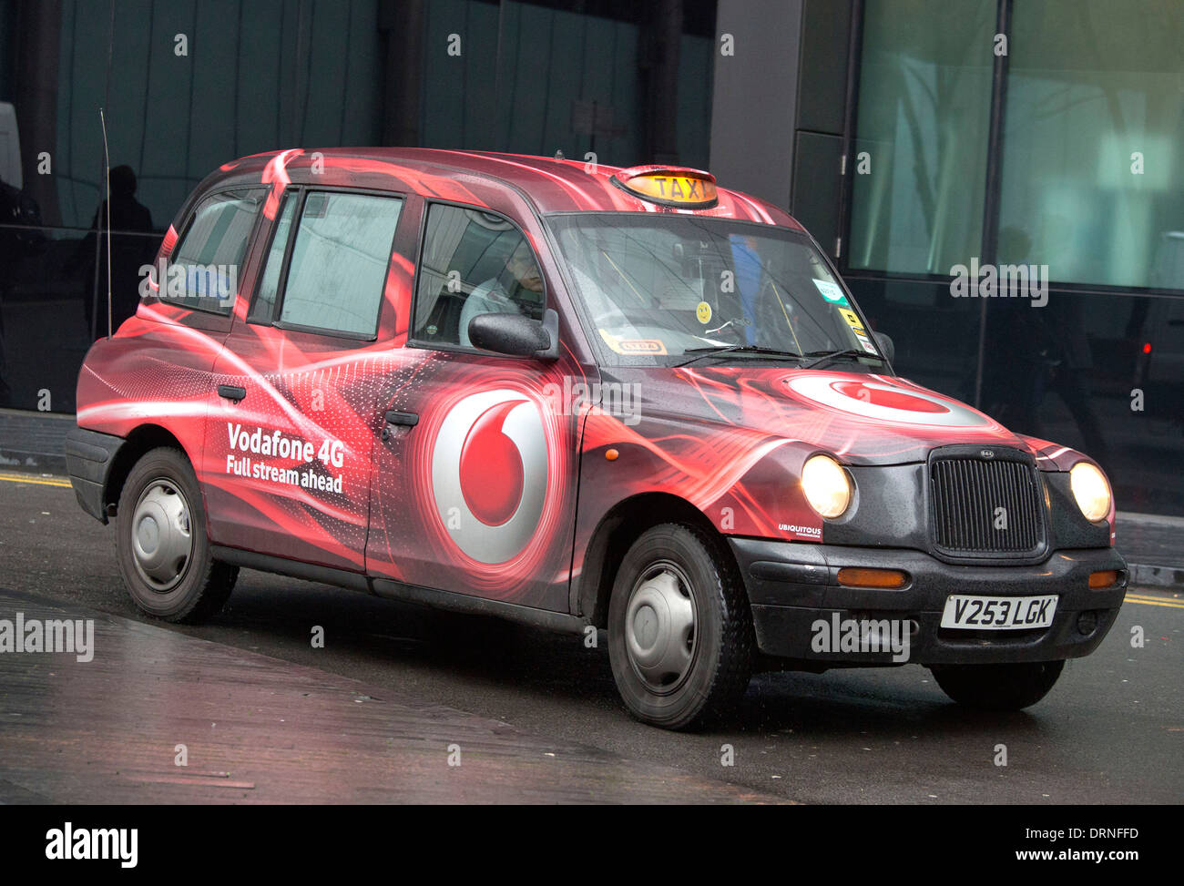 London Taxi cab with Vodafone 4g livery advert - Stock Image