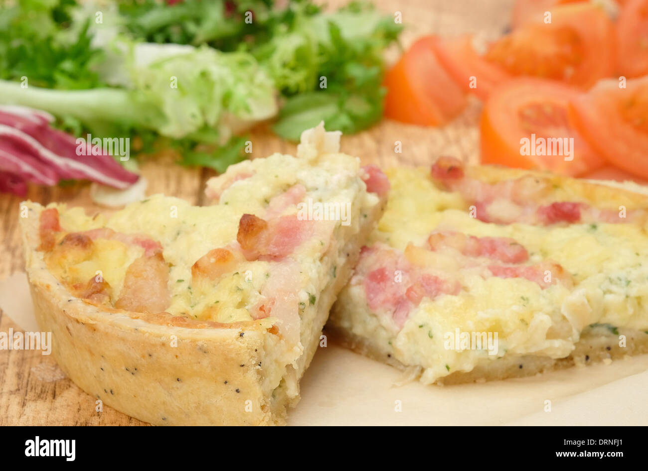 Cheese and bacon Quiche Lorraine - studio shot - Stock Image