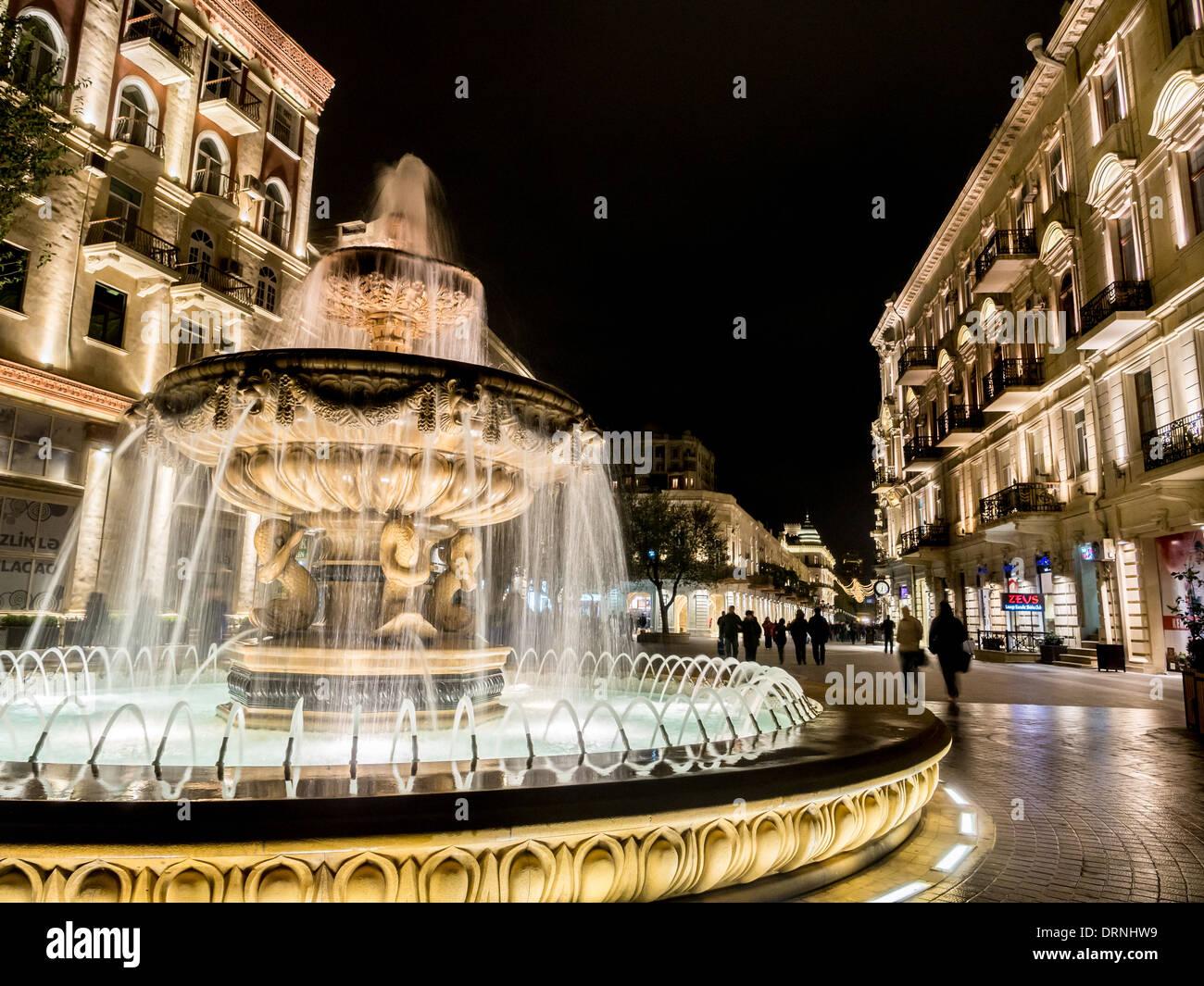 Fountain at the end of the Nizami street in Baku, Azarbaijan, illuminated by night. Stock Photo