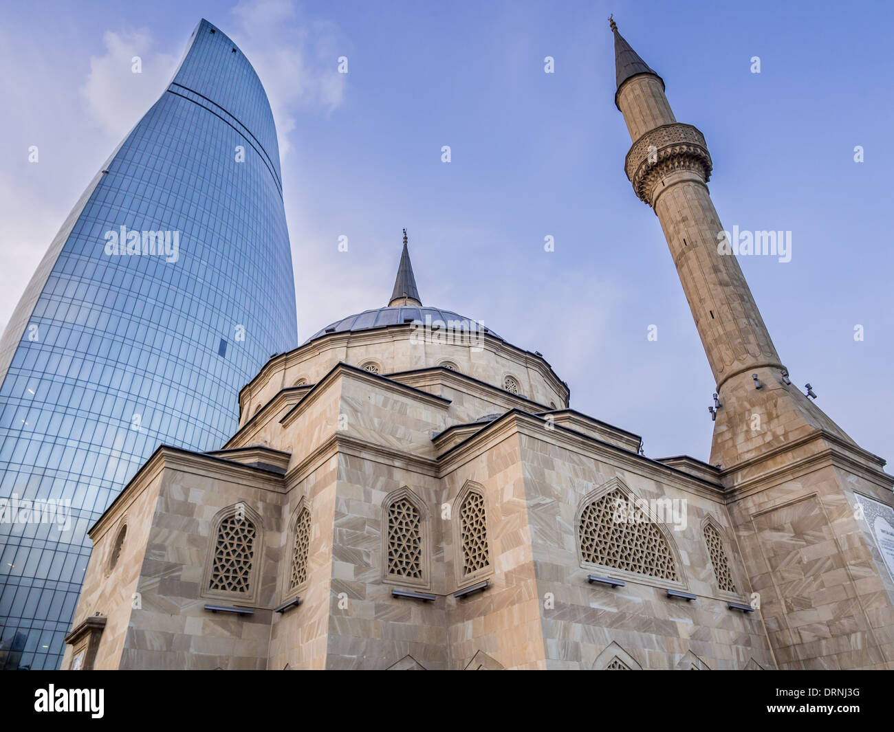 The Mosque of the Martyrs (Sehidler Mescidi Mosque, Turkish Mosque) with the Flame Towers in the background in Baku, Azerbaijan. - Stock Image