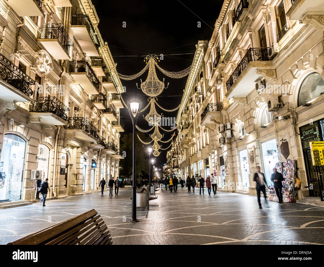 Nizami street in the center of Baku, Azarbaijan, illuminated by night. - Stock Image