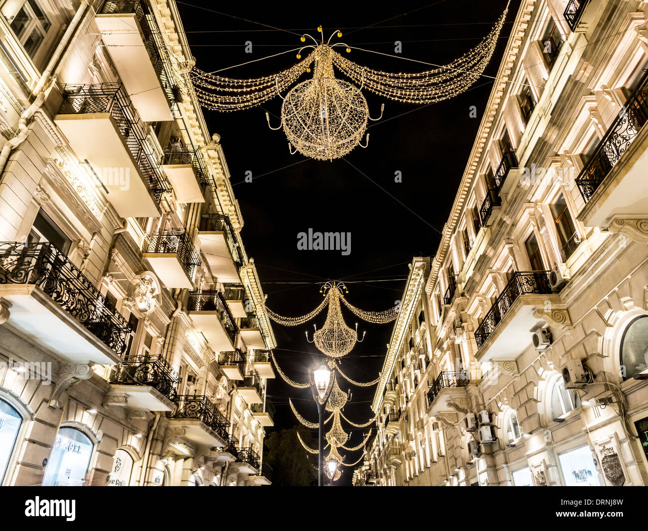 Nizami street in the center of Baku, Azarbaijan, illuminated by night. Stock Photo