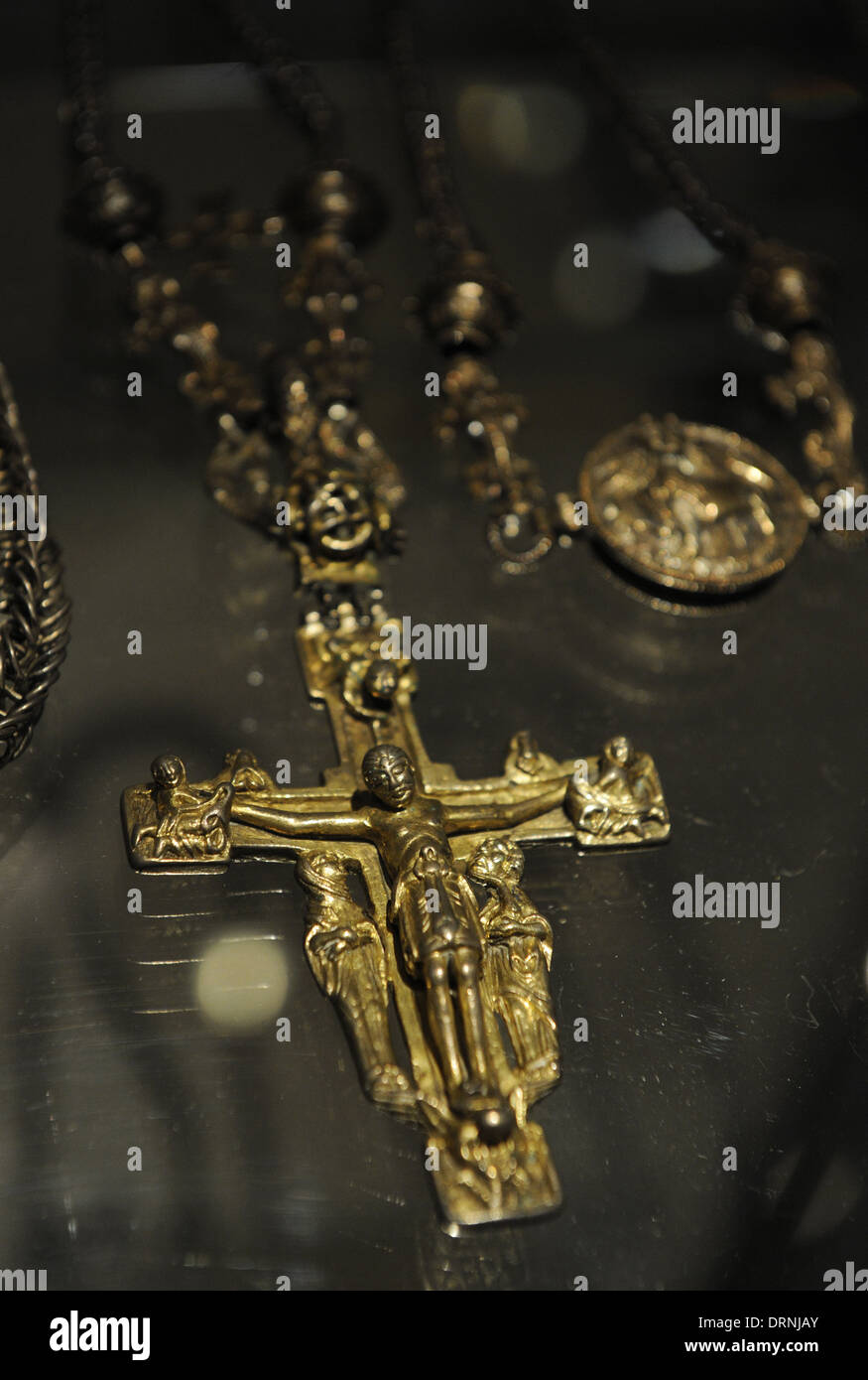 Bishop's Hoard from Halikko. 12th century. Pendant with a gilt crucifix. National Museum of Finland. Helsinki. Finland. - Stock Image