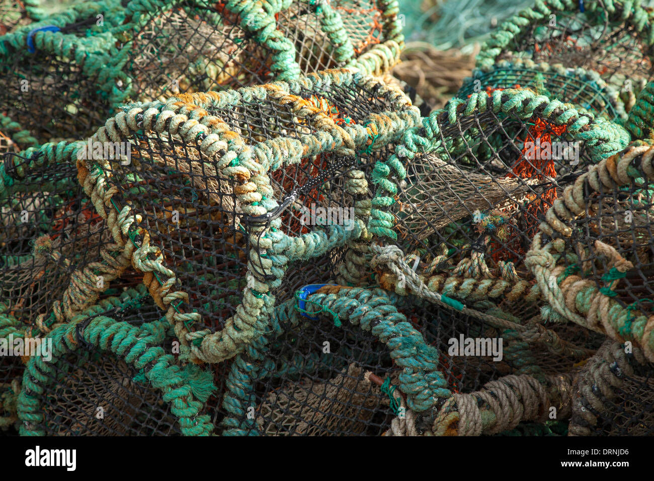 Lobster pots stacked on the pier at Porturlin, County Mayo, Ireland. - Stock Image