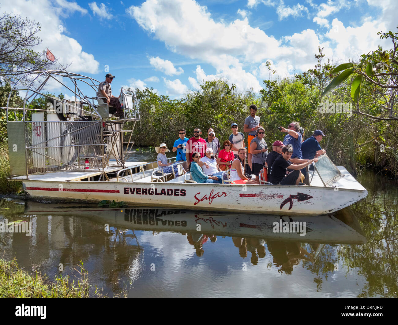 Florida Everglades National Park, USA - Group of tourists on an Airboat sightseeing ride boat tour trip in summer - Stock Image