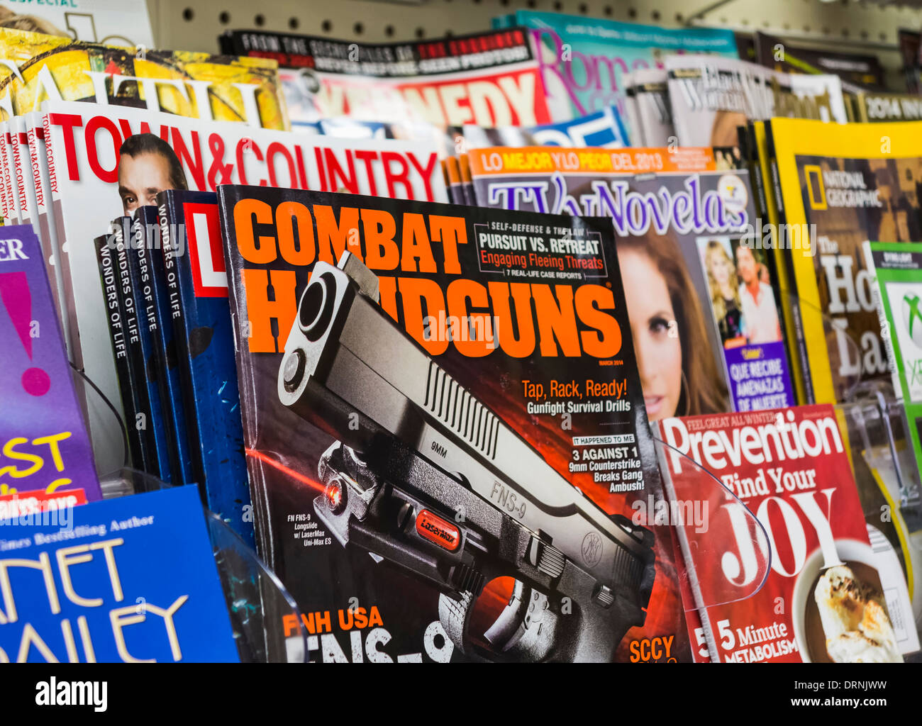 Gun magazine on display in a news store / newsagents, USA - Stock Image