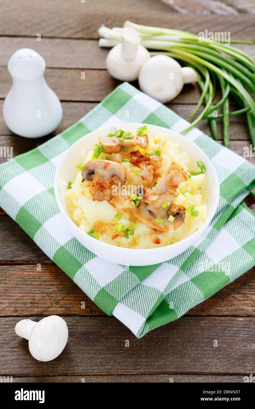 potatoes with mushrooms, food closeup - Stock Image