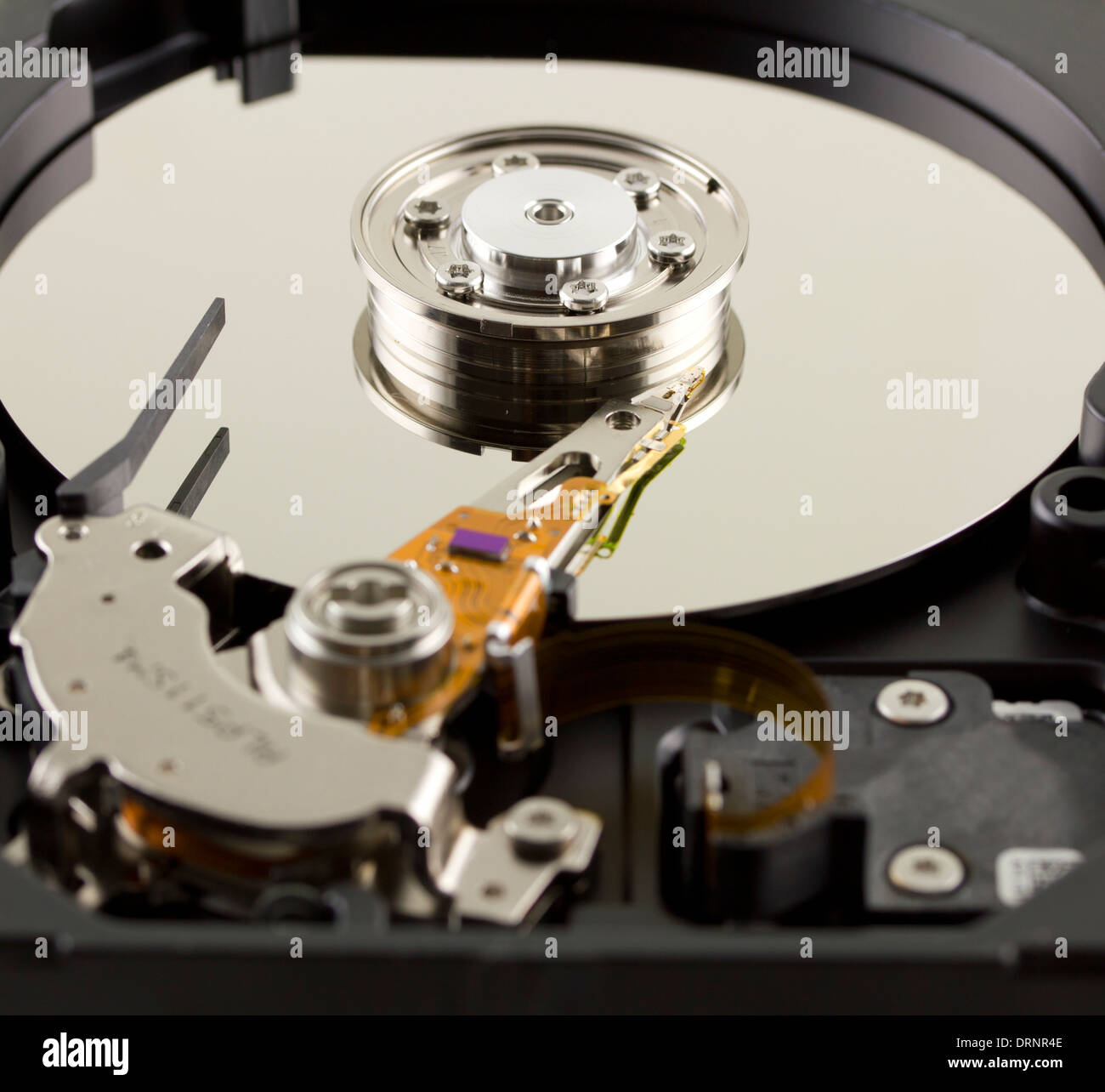 Hard disk from within close up - Stock Image