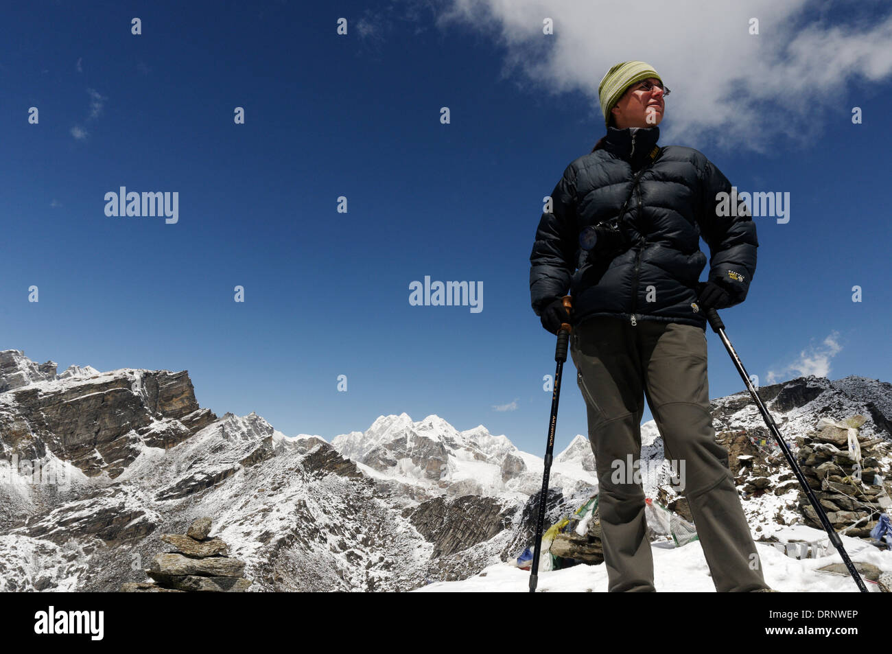A lady trekker on the summit of Gokyo Ri, nepal himalaya - Stock Image