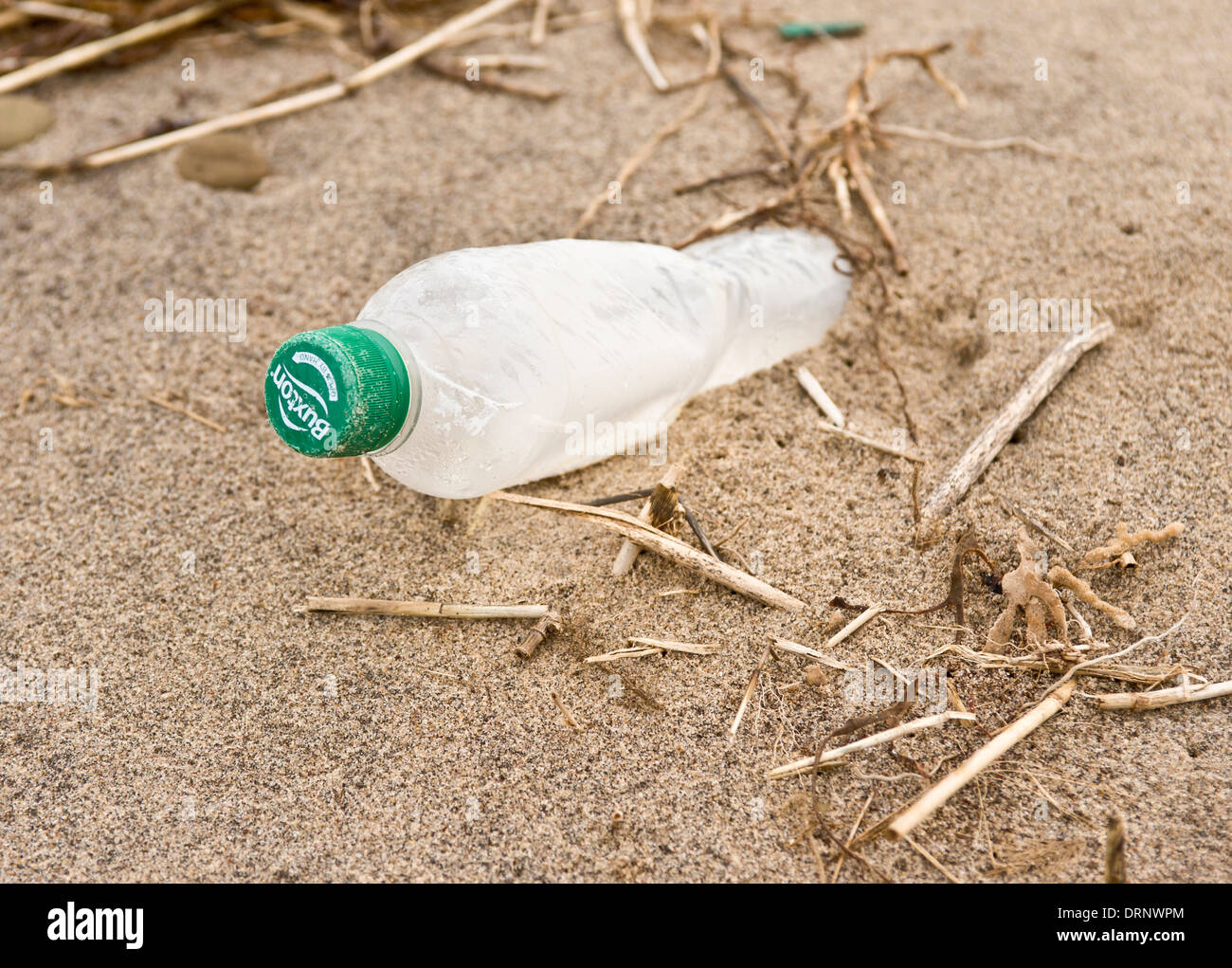 Washed up plastic bottle on beach at Spurn Point - Stock Image