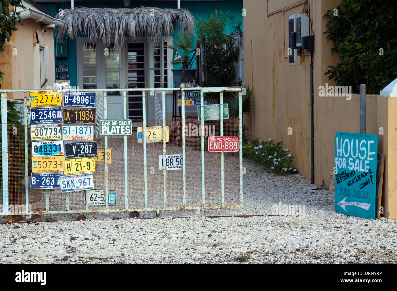 House selling car number plates from across the world in Kralendijk, Bonaire - Stock Image