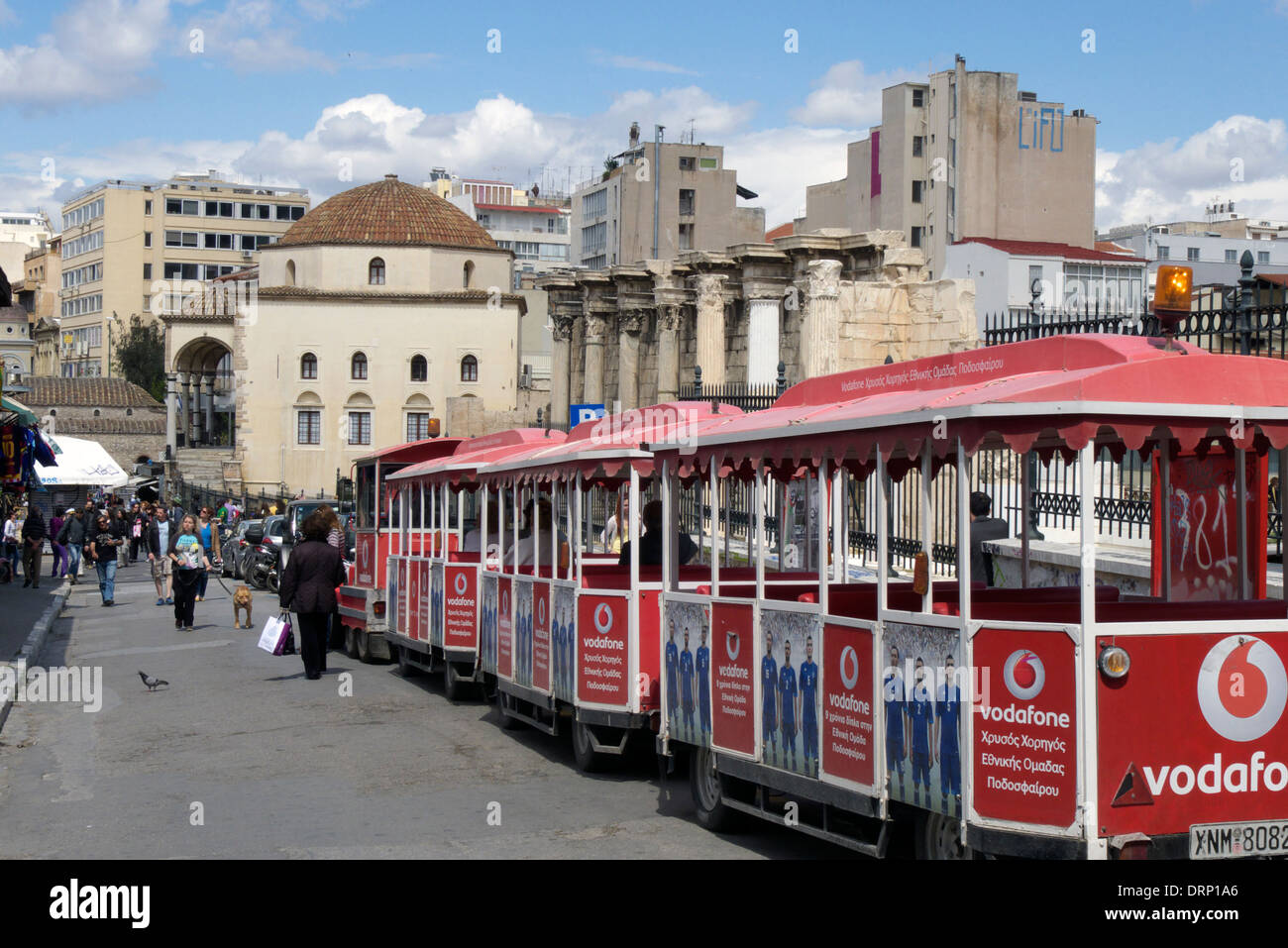 greece attica athens tourist mini train in front of the archaeological site of hadrian's library - Stock Image