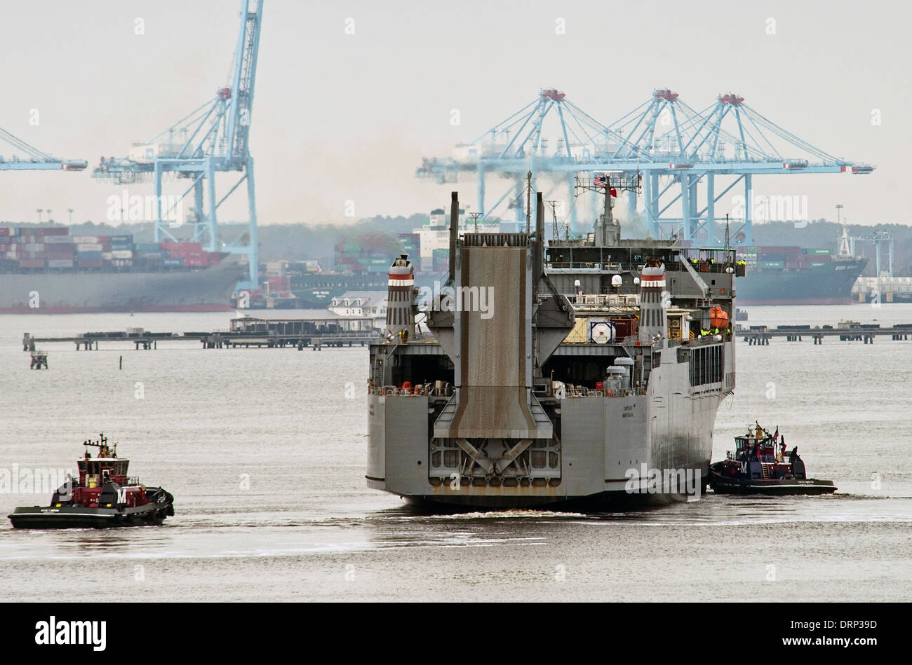 US Navy Ready Reserve Force vehicle transport ship Cape Ray pulls out of Norfolk Naval Shipyard on the way to Italy to begin processing Syrian chemical weapons January 10, 2014 in Portsmouth, Virginia. The Cape Ray has been fitted with equipment to destroy Syrian Chemical weapons at sea as part of a U.N. agreement. - Stock Image