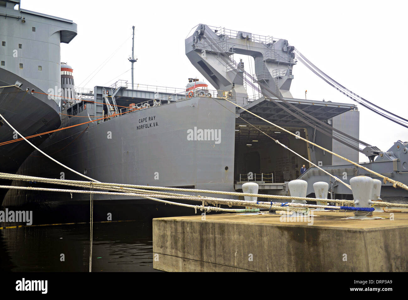 US Navy Ready Reserve Force vehicle transport ship Cape Ray docked at Norfolk Naval Shipyard before departing to - Stock Image