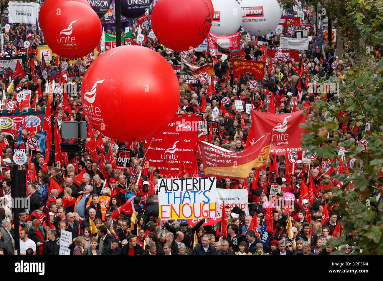 Trade unions members participating in a TUC march in protest against the government's austerity measures - Stock Image