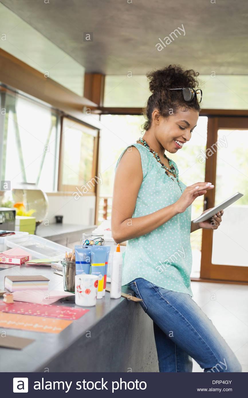 Stationary designer using digital tablet - Stock Image