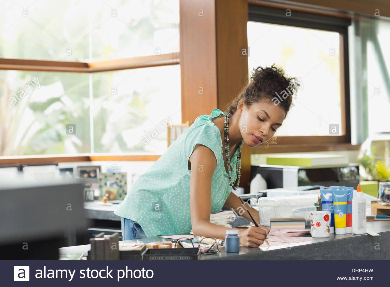 Stationary designer working in studio - Stock Image
