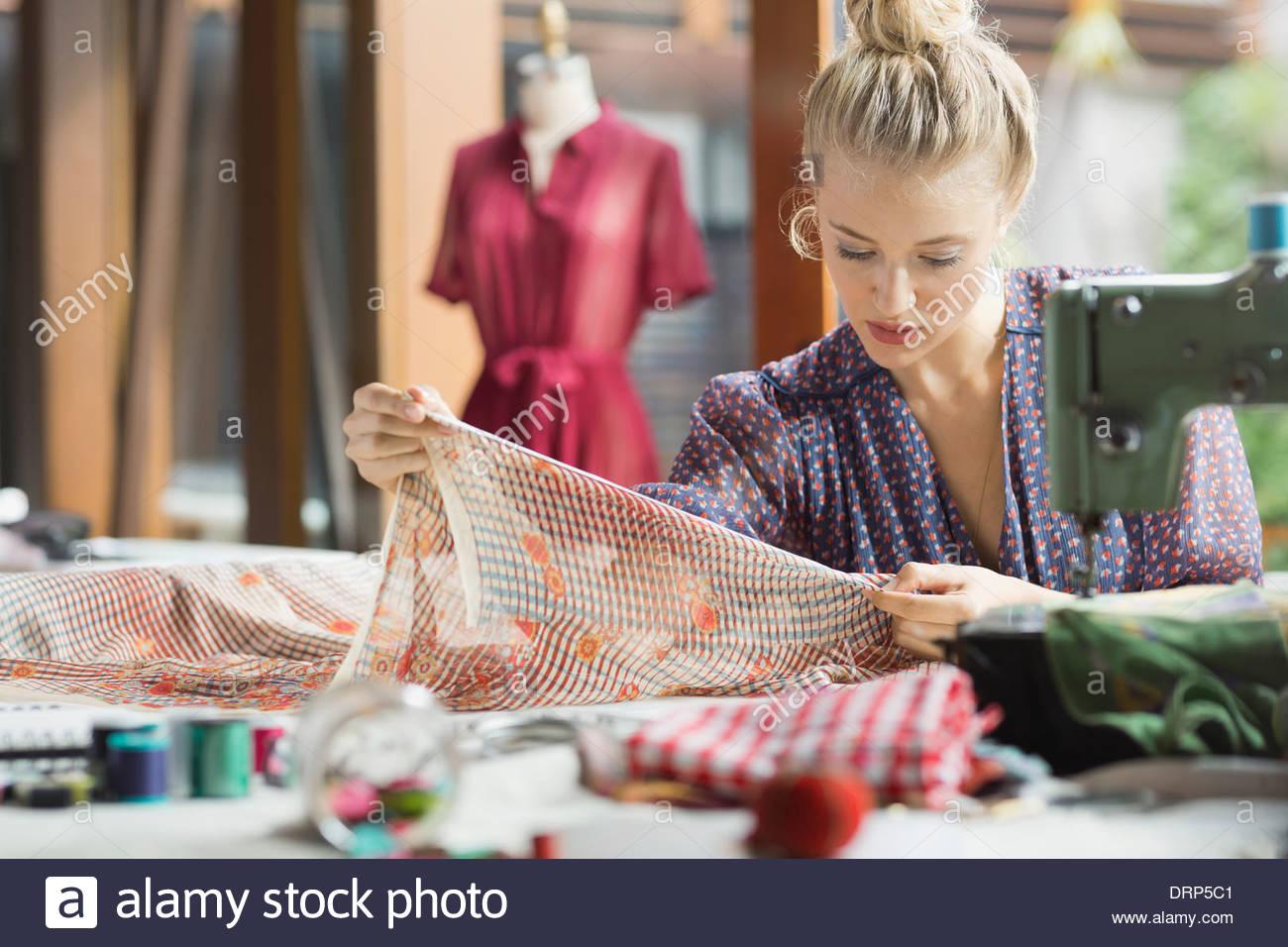 Fashion designer working in studio - Stock Image