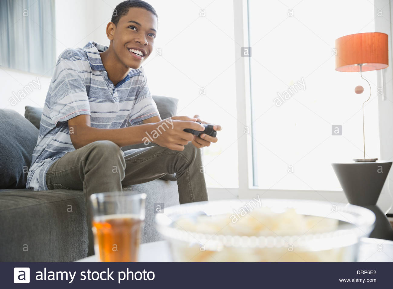 Teen playing video games at home - Stock Image