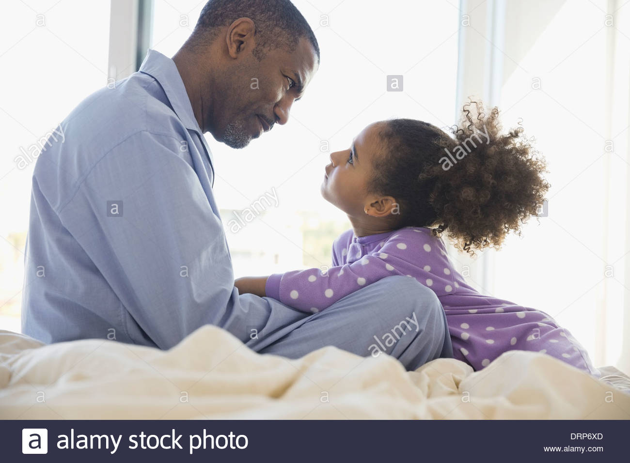Father and daughter looking at each other - Stock Image