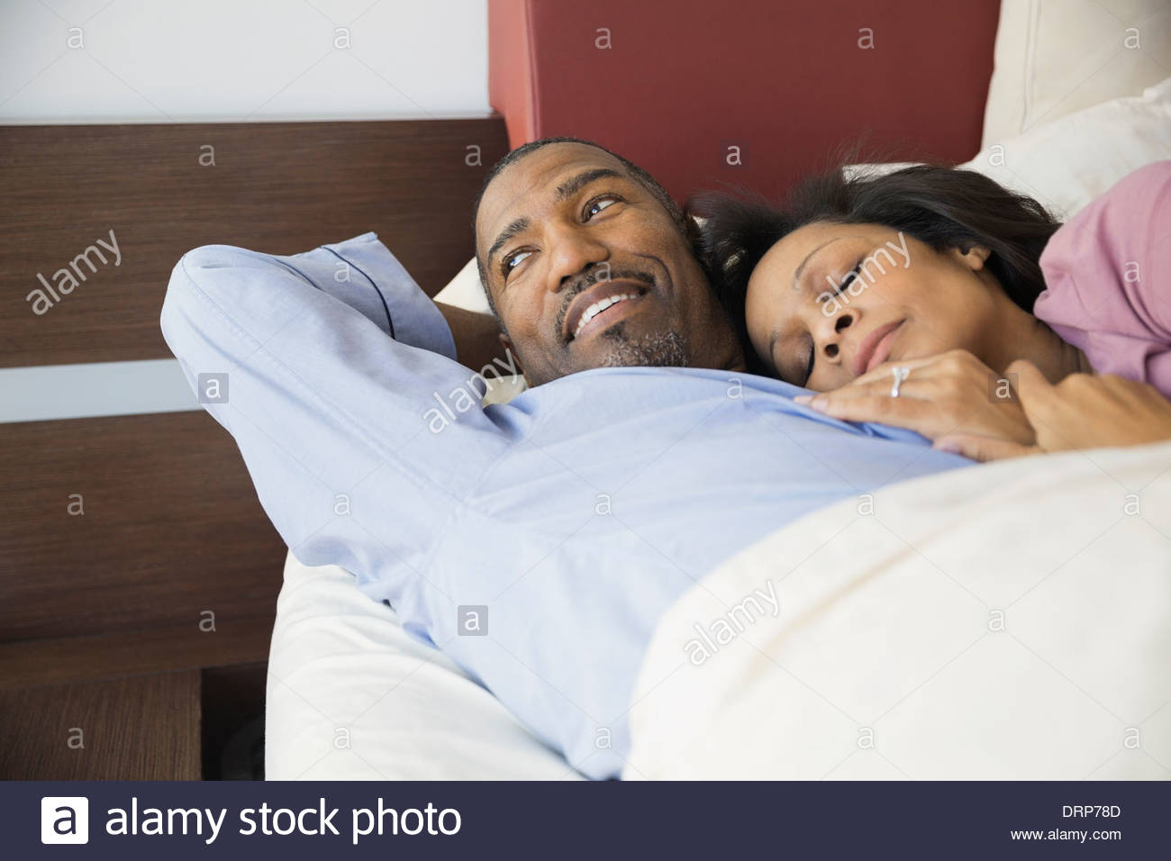 Couple resting in bed - Stock Image