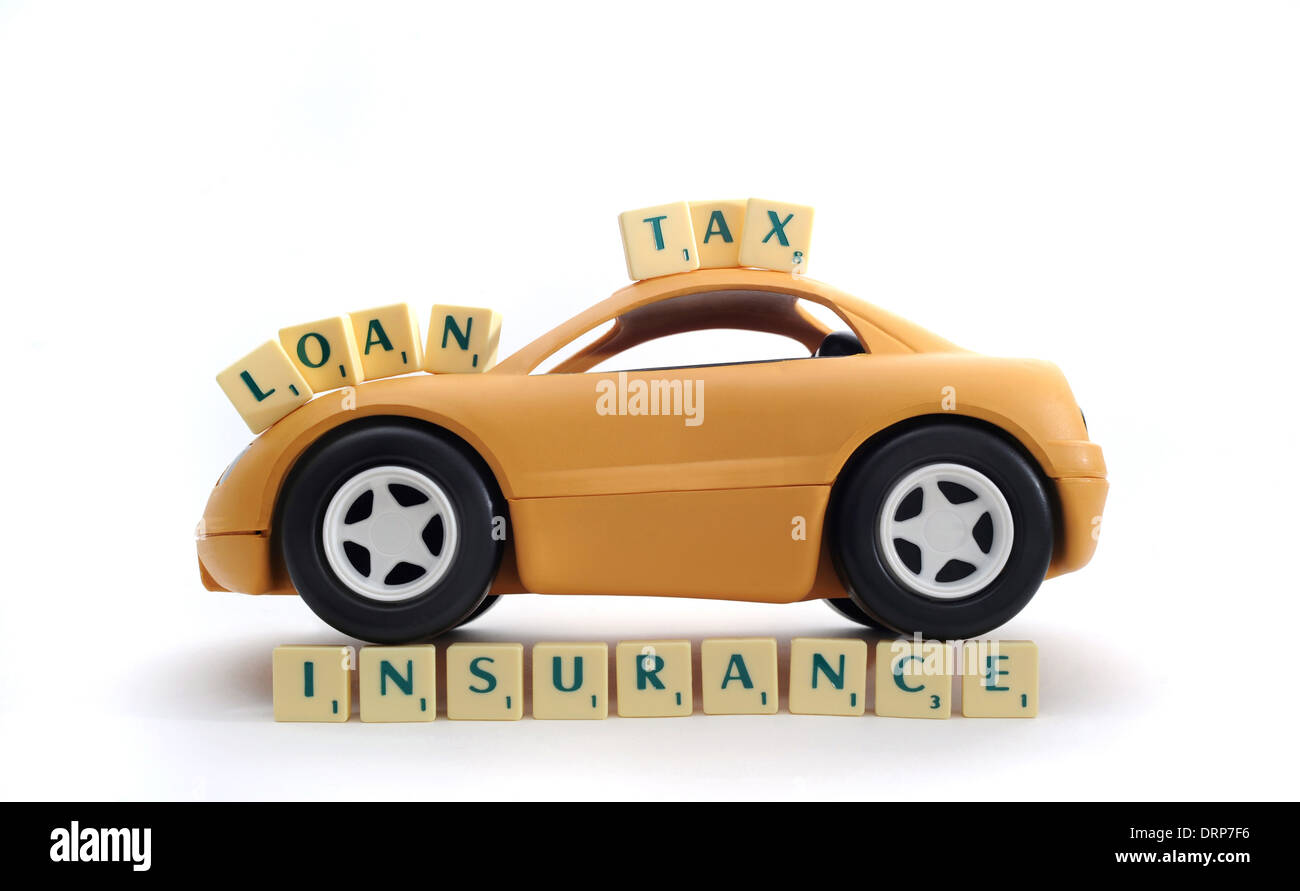 YELLOW CAR WITH WORD TILES RE INSURANCE POLICY TAX LOANS RISING MOTORING COSTS PRICES BUYING SELLING CARS NEW DEPRECIATION UK - Stock Image