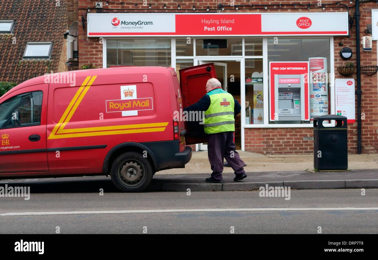 Postman loading a van outside a post office, Hayling Island, Hampshire, UK - Stock Image