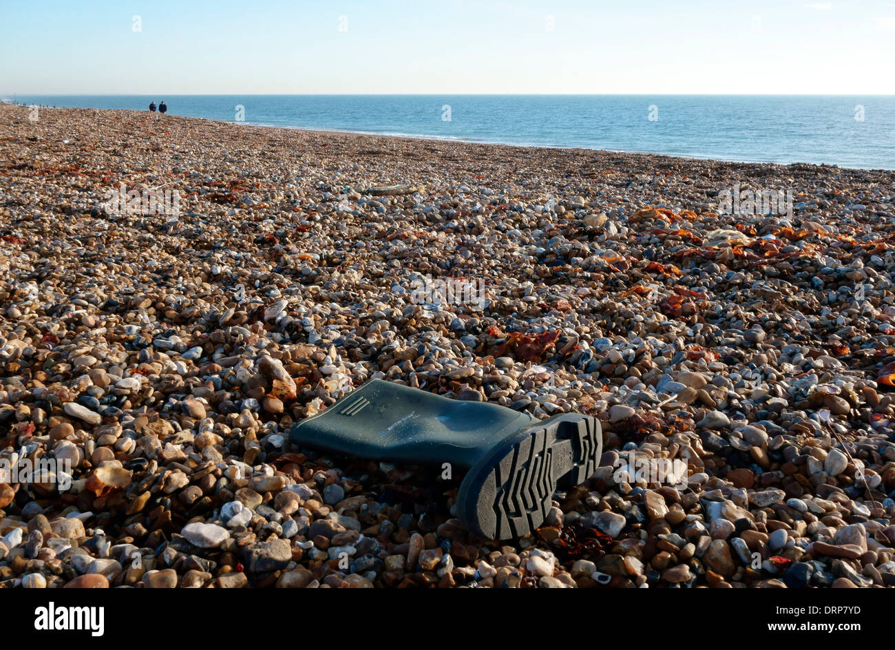 Welly boot on the beach, Hayling Island, Hampshire, UK Stock Photo