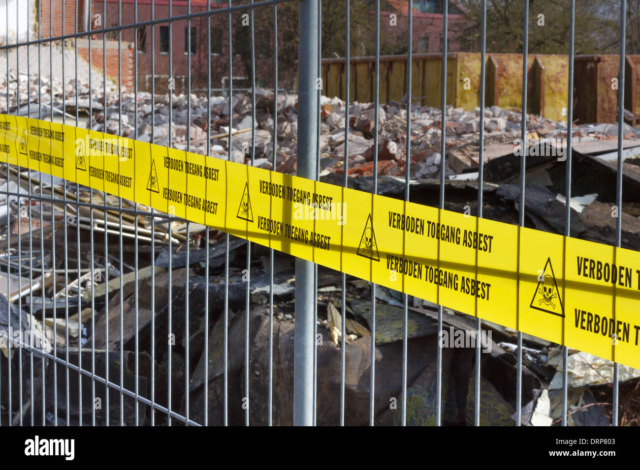 Yellow no Trespassing tape for asbestos in dutch at entrance of contaminated terrain - Stock Image