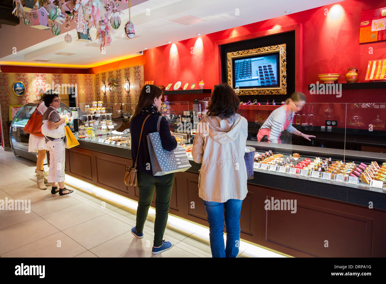 Shoppers in Patisserie and Chocolatier shop Carbillet in Rue des Forges in Dijon in the Burgundy region of France Stock Photo