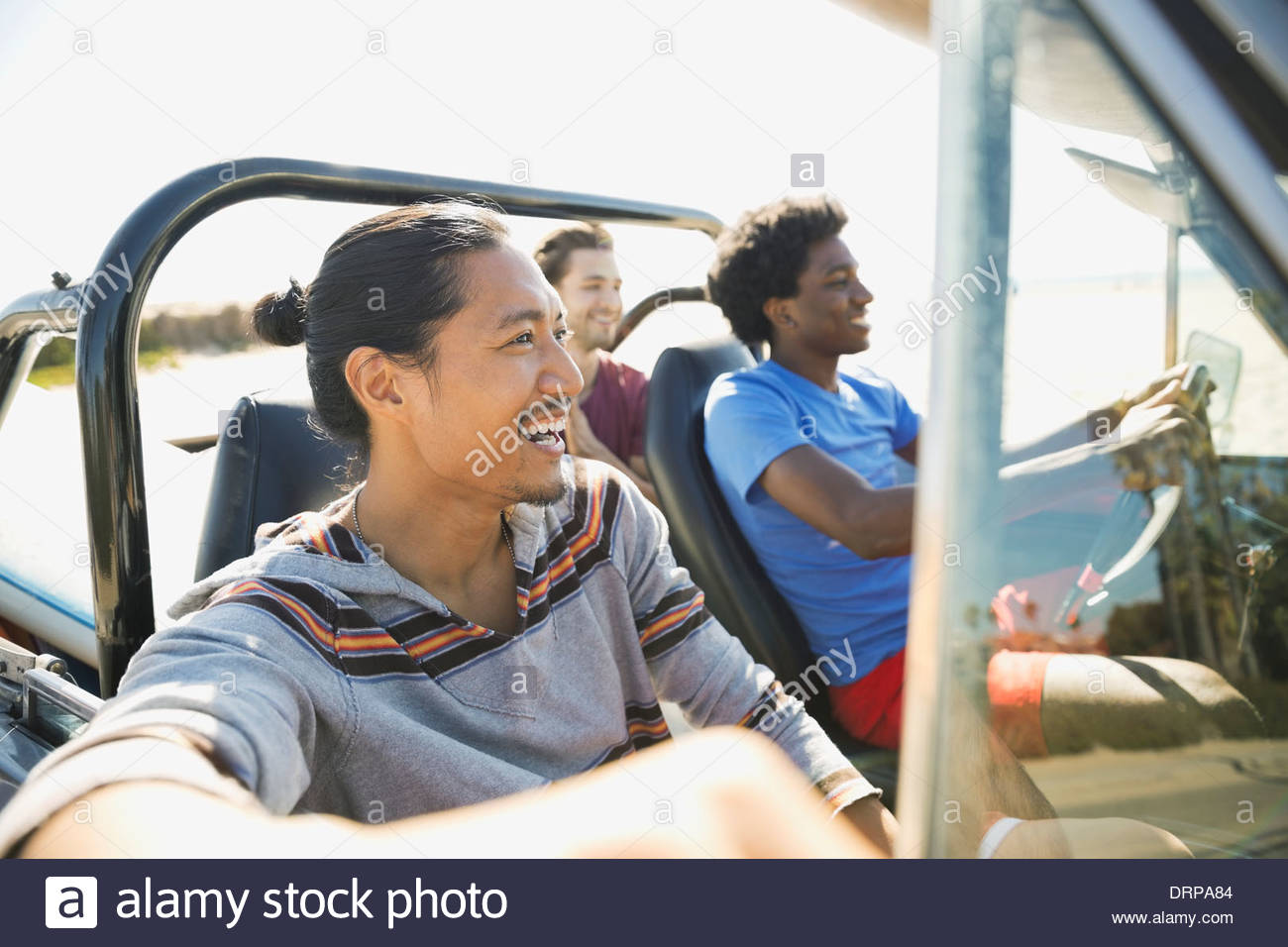 Male friends enjoying road trip - Stock Image