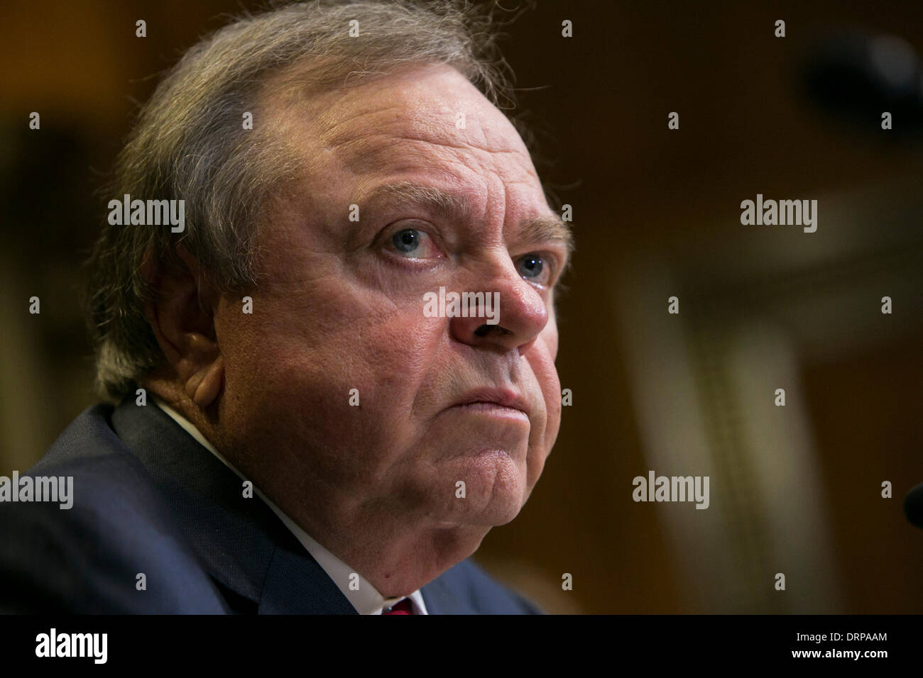 Washington DC, USA . 30th Jan, 2014. Harold Hamm, chairman and CEO of Continental Resources testifies before the Senate Energy and Natural Resources Committee during a hearing on U.S. oil exports in Washington, D.C., on January 30, 2014. Credit:  Kristoffer Tripplaar/Alamy Live News - Stock Image