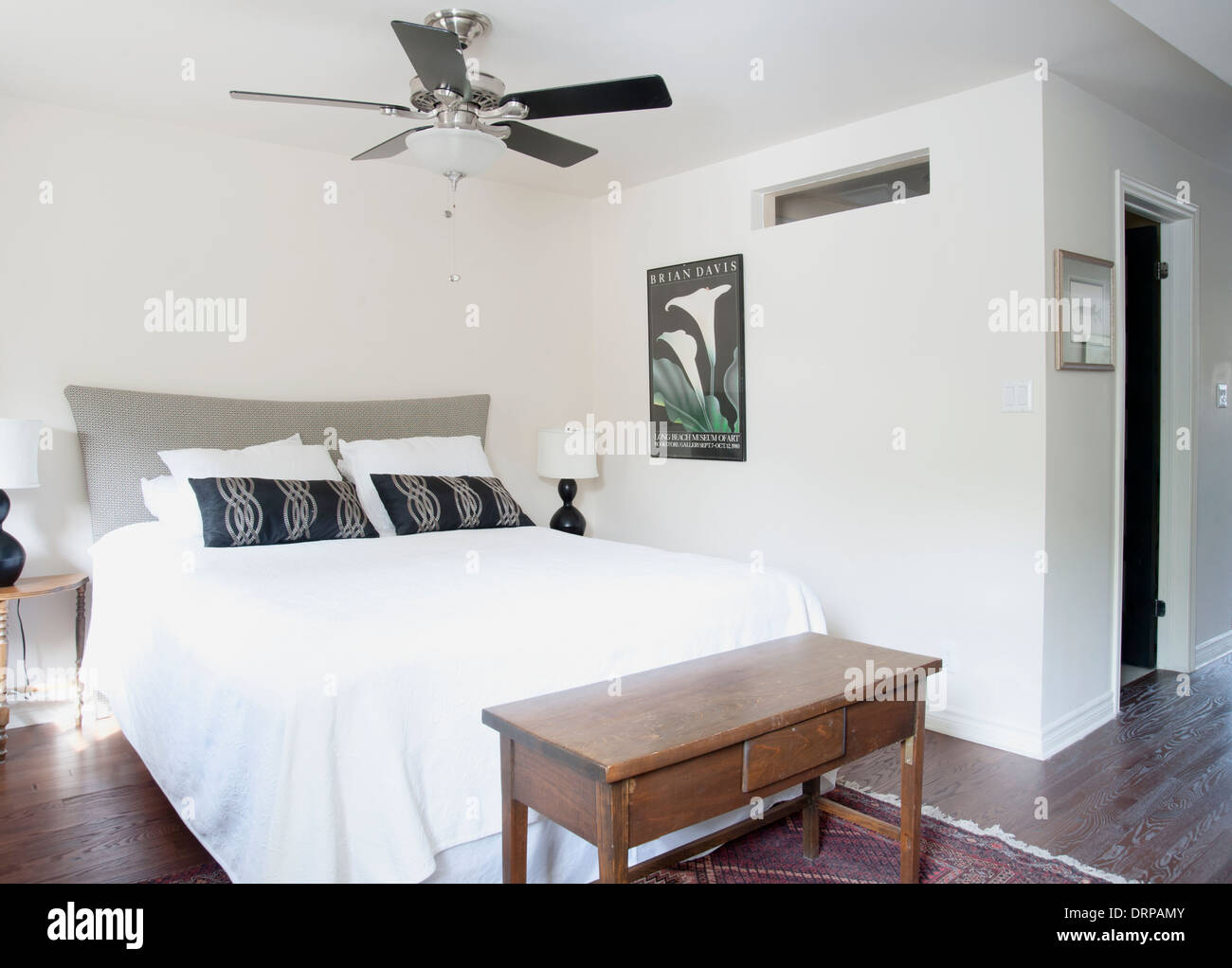 Bedroom in modern apartment flat with open concept - Stock Image