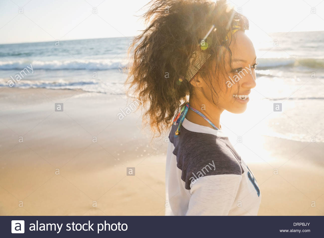 Woman spending leisure time at beach - Stock Image