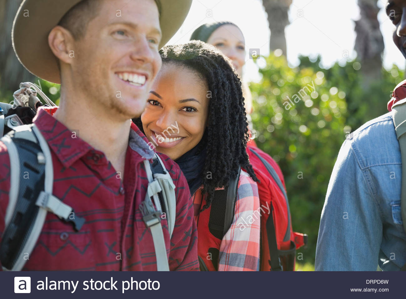 Female backpacker with friends outdoors - Stock Image