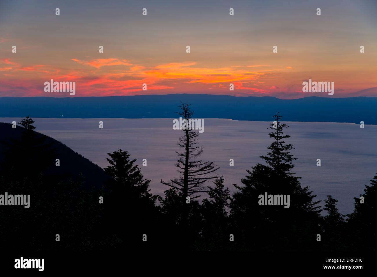 Sunset over Lac Leman, Lake Geneva, France looking towards Switzerland - Stock Image