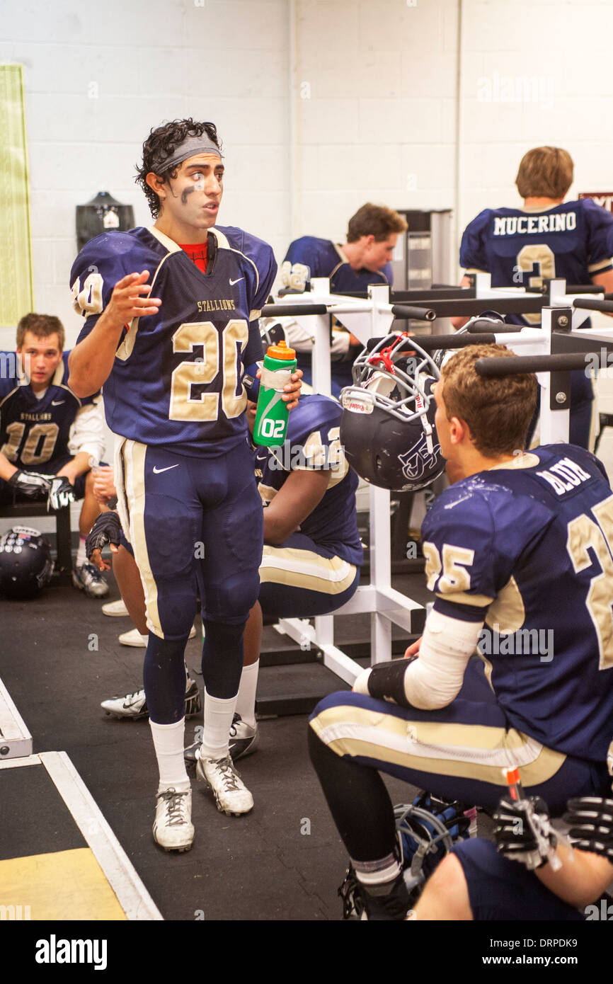 High School Football Players Discuss The Game During Half Time In Stock Photo -5490