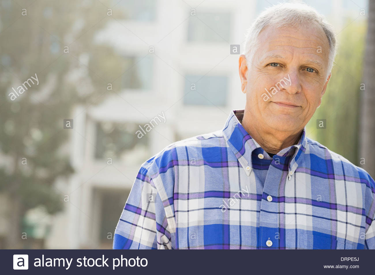 Portrait of senior man outdoors - Stock Image
