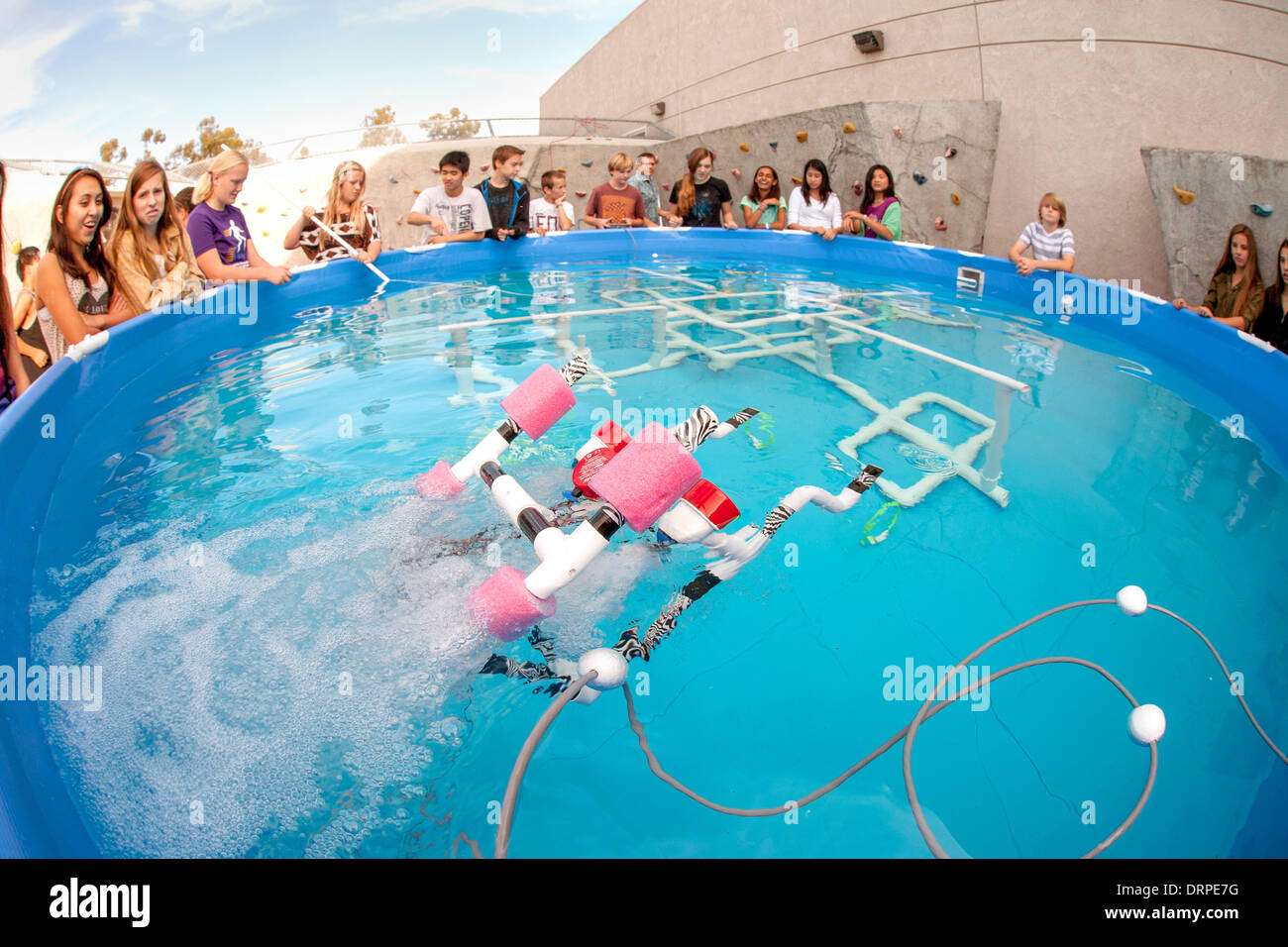 Multiracial middle school students in Mission Viejo, CA, test the remote operated submarine vehicles (ROV) they Stock Photo