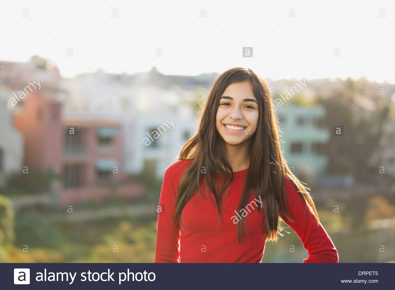 Portrait of girl standing outdoors - Stock Image