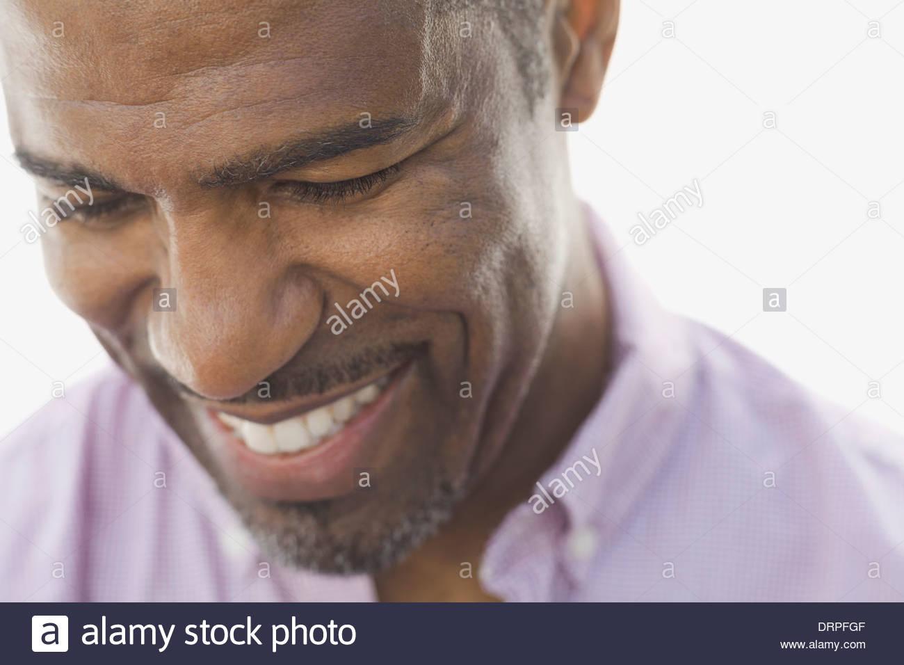 Close-up of smiling man - Stock Image