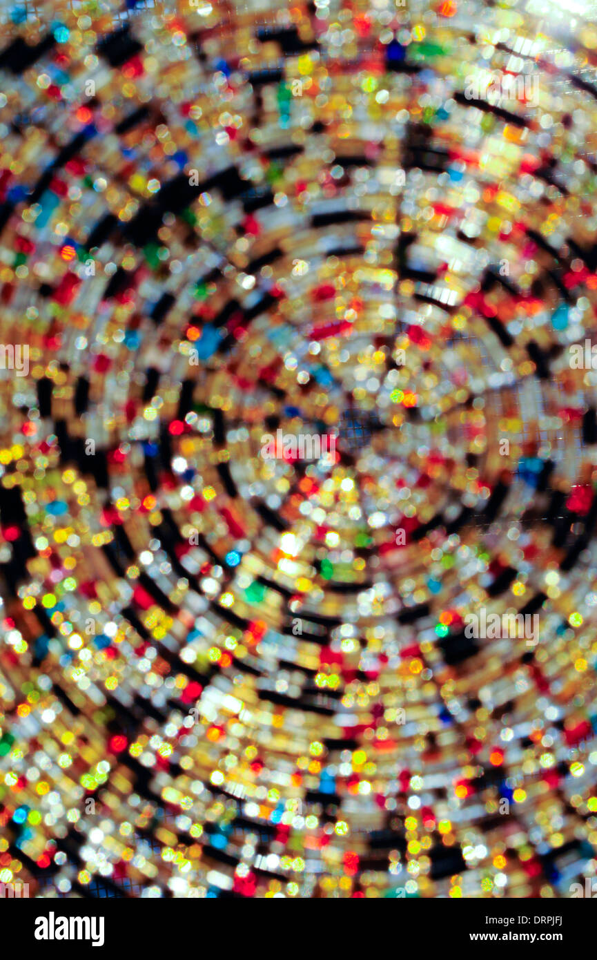 Glass beads with sun shining through them. - Stock Image