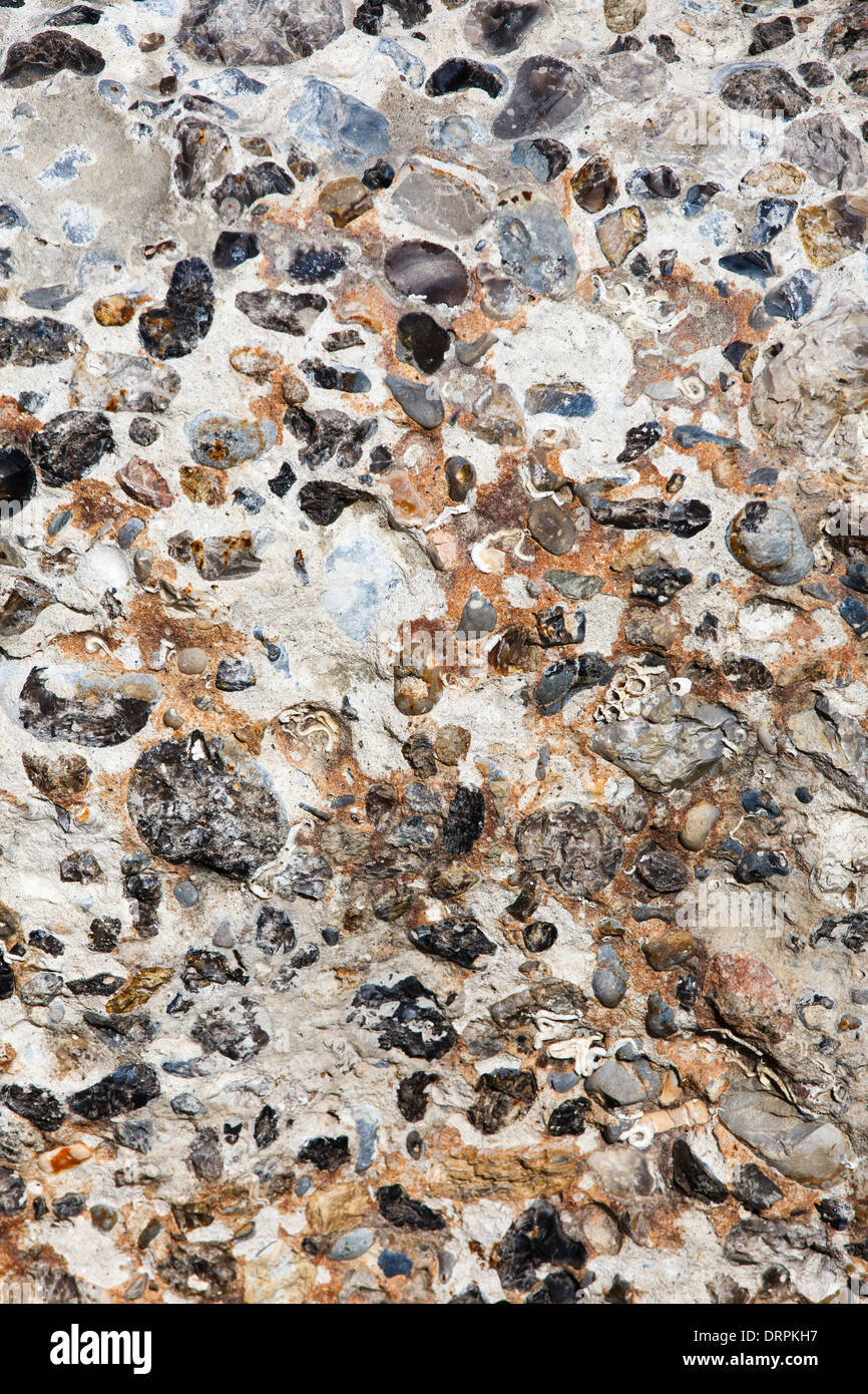 Concrete wall of gravel - Stock Image