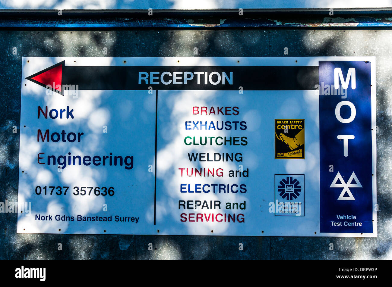 Sign for garage services, including MOT. - Stock Image