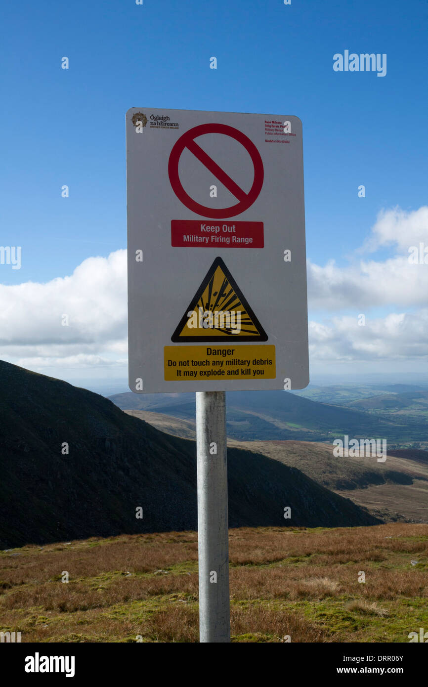 Warning sign for the Glen of Imaal Artillery Range, Lugnaquilla, Wicklow Mountains, County Wicklow, Ireland. - Stock Image