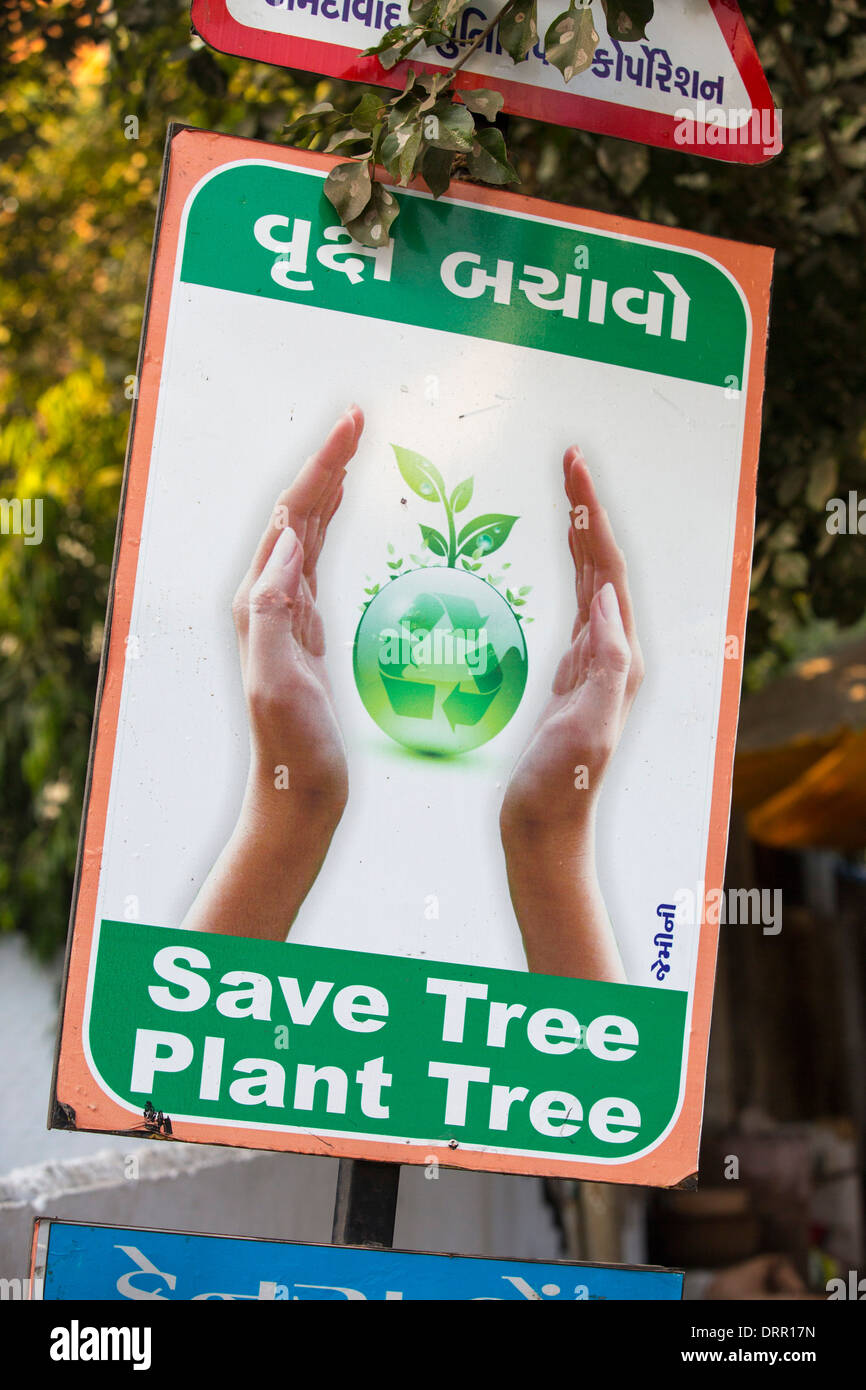 A sign about planting trees in Ahmedabad; India; - Stock Image