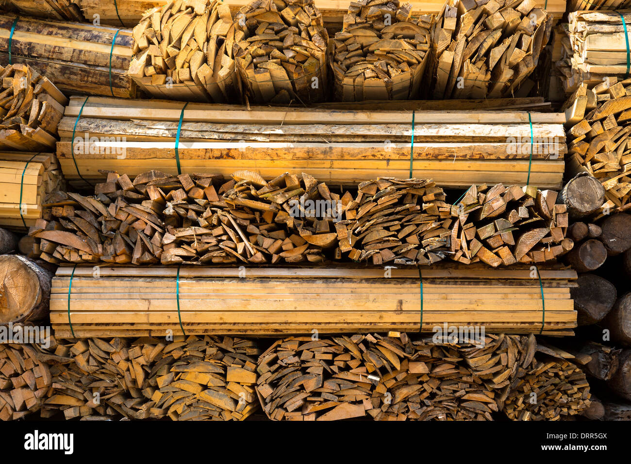 Timber planks, stacked to become seasoned wood at Interlaken in the Bernese Oberland, Switzerland - Stock Image
